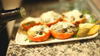 Seasoning a vegetable meal with olive oil before serving