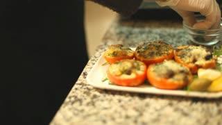 Seasoning a vegetable meal with salt before serving