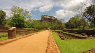 SIGIRIYA, SRI LANKA - MARCH 2014: Timelapse view of people walking in park below from Sigiriya rock.