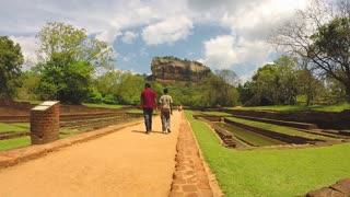 SIGIRIYA, SRI LANKA - MARCH 2014: View of people walking in park below from Sigiriya rock.
