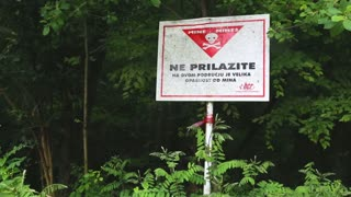 Sign of danger of mines in the forest in Croatia, who spends 35 million euro a year demining their country.