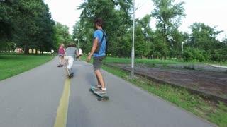 Skateboarders riding on a skate