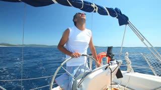 Skipper on sailing boat on Adriatic sea off the coasts of Croatia.