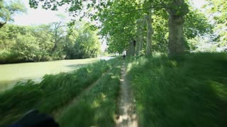 Slow motion - Cycling on track next to Canal du Midi in France