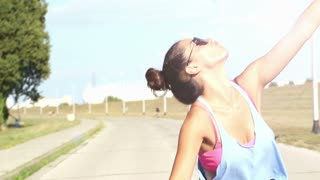 Slow motion of beautiful young woman taking selfies and having fun while riding a bicycle, graded