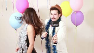 Slow motion of couple in love in photo booth