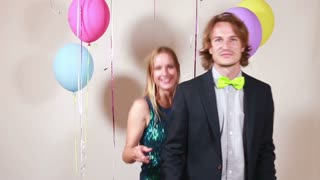 Slow motion of cute couple dancing in photo booth