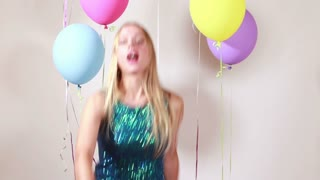 Slow motion of happy woman dancing in photo booth