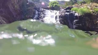 Slow motion of waterfall filmed from the river in Ella, Sri Lanka.