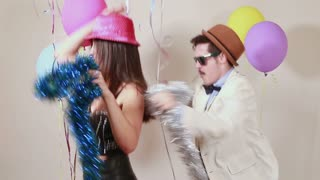 Slow motion of woman and man having awesome time dancing in photo booth