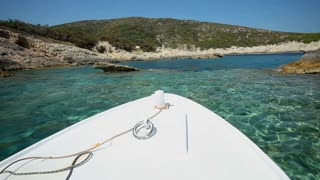Small wooden passenger boat returning from blue cave on Bisevo island in Croatia