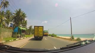 SOUTHERN COAST, SRI LANKA - FEBRUARY 2014: Beautiful view of tropical Sri Lankan landscape from tuktuk on a sunny summer day.