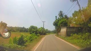SOUTHERN COAST, SRI LANKA - FEBRUARY 2014: View of Sri Lankan countryside landscape from a moving vehicle.