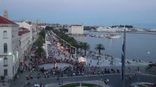 SPLIT, CROATIA - JULY 24, 2013: Timelapse of tourists at night on the promenade on June 24, 2013 in Split, Croatia. Split is the largest city on the dalmatian coast.
