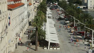 SPLIT, CROATIA - JULY 24, 2013: Timelapse of tourists on seafront promenade on June 24, 2013 in Split, Croatia. Split is the largest city on the Dalmatian coast.