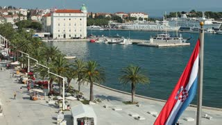 SPLIT, CROATIA - JULY 24, 2013: View of harbour and seafront promenade on July 24, 2013 in Split, Croatia. Split is the largest city on the Dalmatian coast.