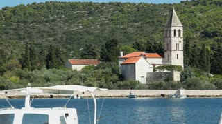 SPLIT - JULY 24: View of church leaving the harbour and bay on July 24, 2013 on the island of Vis, Croatia. Vis is the farthest inhabited island off the Croatian mainland with a population of 3,460.