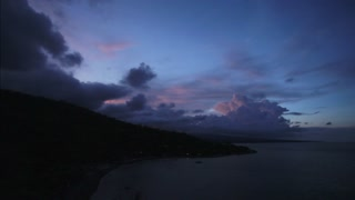 Sunset with amazing colourful sky and clouds in bay in Amed, Bali, Indonesia