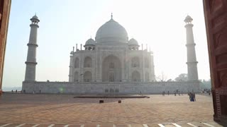 Taj Mahal front view from entrance with wooden doors.