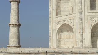 Taj Mahal's side wall and tower, closeup.