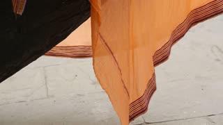 Textile hanging from boat front, closeup.