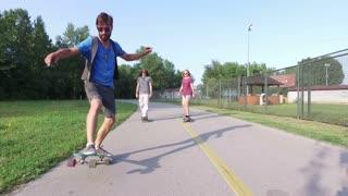 Three young people having fun skateboarding