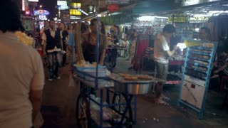 TIMELAPSE Food vendors on Khao San Road at night on 20 November 2012 in Bangkok, Thailand. Khao San road is the mekka for all tourists arriving in the capital.