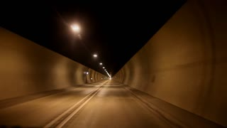 Timelapse of car driving through tunnels
