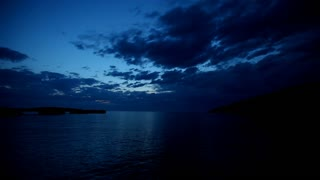Timelapse of clouds moving over sea at twilight in Croatia