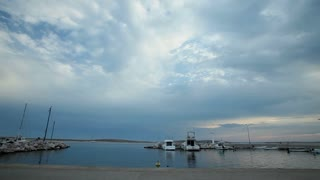 Timelapse of clouds passing over harbour on Croatian island.