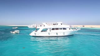 Tour boats anchored next to Paradise island in the Red sea, Egypt