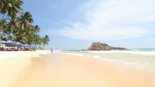 Tourist walking on sandy beach