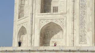 Tourists at Taj Mahal' side wall's patio.