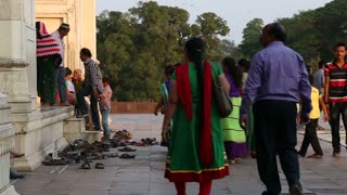 Tourists walking through the courtyards of Taj Mahal.