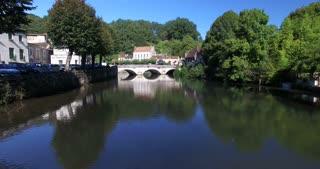 Tracking shot of old stone bridge in Brantome in Dordogne, France