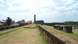 Tracking shot of the Galle fort walls protecting the main town.