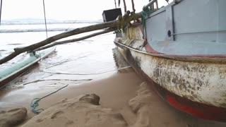 Traditional fishing boat on the beach in Weligama, Sri Lanka