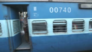 Train wagons from outside, view from moving train in Amritsar.