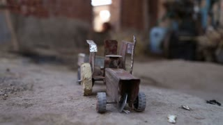 Truck toy on ground in house in Jodhpur, closeup.