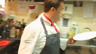 Two chefs cooking in the restaurant kitchen