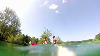 Two male friends having fun in a canoe