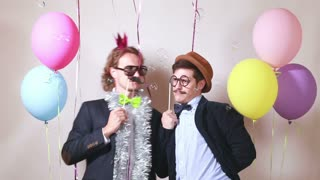 Two male friends having fun with props