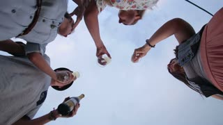 Under view of group of friends toasting with champagne