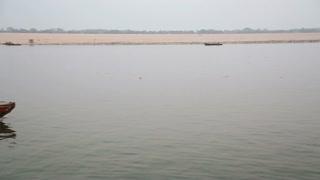 VARANASI, INDIA - 20 FEBRUARY 2015: Boat full of people sailing through river Ganges in Varanasi.