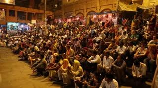 VARANASI, INDIA - 20 FEBRUARY 2015: Crowd applauding at Ganga Aarti ritual in Varanasi.