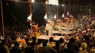 VARANASI, INDIA - 20 FEBRUARY 2015: Crowd gathered around hindu priests performing Ganga Aarti ritual.