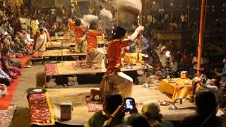 VARANASI, INDIA - 20 FEBRUARY 2015: Crowd watching hindu priests performing at Ganga Aarti ritual in Varanasi.