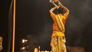 VARANASI, INDIA - 20 FEBRUARY 2015: Hindu priest performing with fire at Ganga Aarti ritual in Varanasi.