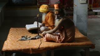 VARANASI, INDIA - 20 FEBRUARY 2015: Two hindu men praying at the street in Varanasi.