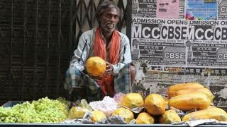 VARANASI, INDIA - 22 FEBRUARY 2015: Indian man selling fruits on the street of Varanasi.